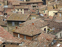 Sienese rooftops feature appropriately-colored satellite dishes