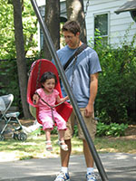 Lee pushing Julia in a swing